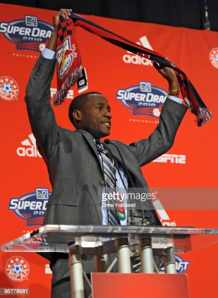 The second overall draft pick Tony Tchani of the New York Red Bulls raises his team scarf during the 2010 MLS SuperDraft on January 14 2010 at the...