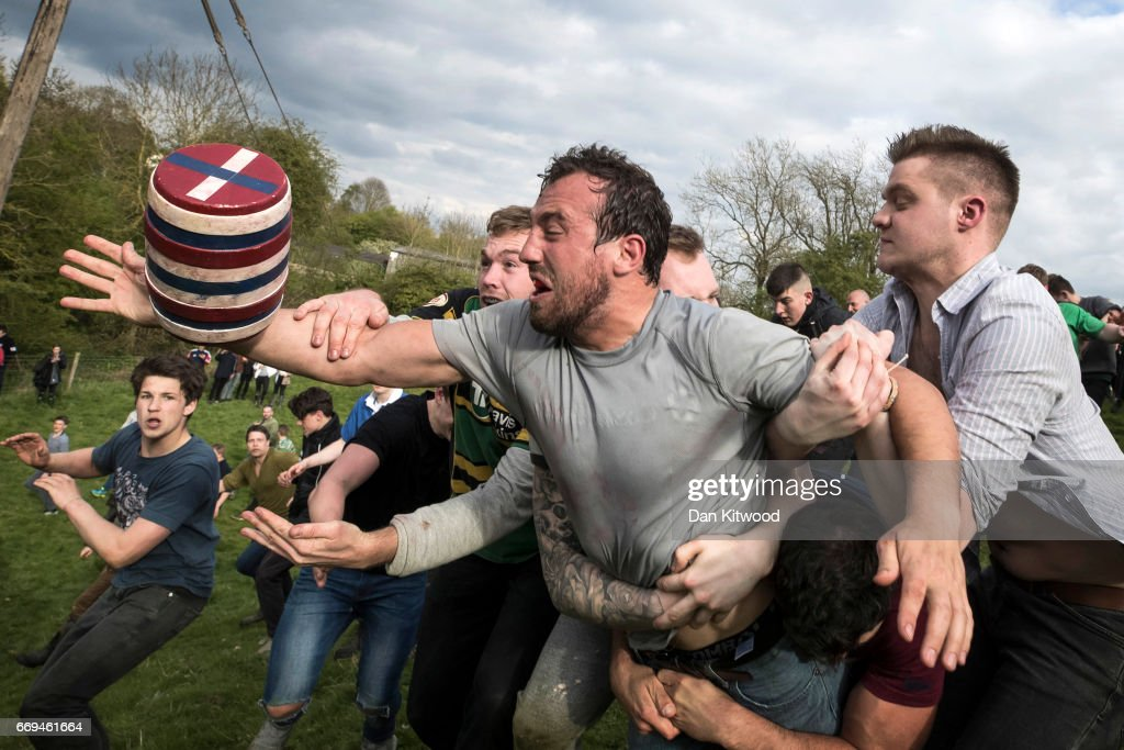 The second round of the bottle Kicking gets underway over the Hare Pie Hill on April 17, 2017 in Hallaton, England. Hallaton hosts the Hare Pie Scramble and Bottle Kicking event today. The Bottle Kicking follows the Hare Pie Scramble, two events that are combined to form an ancient custom that dates back to the early eighteenth century, and one of the oldest in British History. The first part consists of a blessing of a Hare Pie by a local vicar, before it is cut up and thrown to the crowd, who 'scramble' to get a piece, believing it will bring good luck. The second part, the Bottle kicking sees two rival villages, Hallaton, and neighboring Medbourne attempt to carry a 'bottle' which is actually a keg of beer, from the Hare Pie Bank, and get it across a boundary stream for their own village. The best of three contest can last several hours.
