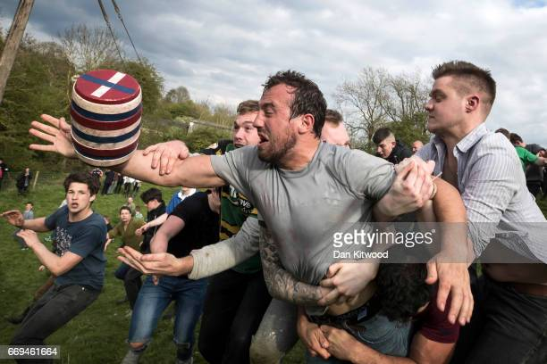The second round of the bottle Kicking gets underway over the Hare Pie Hill on April 17 2017 in Hallaton England Hallaton hosts the Hare Pie Scramble...