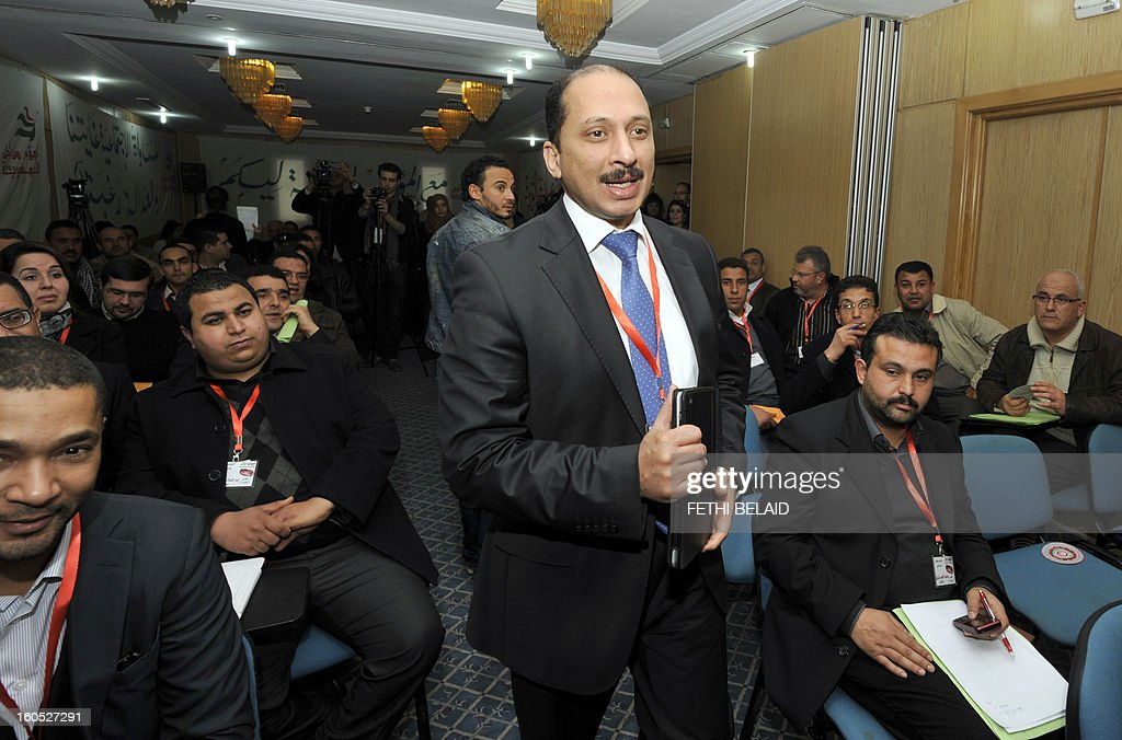 The Secretary General of the Congress Party for the Republic (CPR) Mohamed Abbou arrives to preside over the extraordinary National Council of his party as they debate the upcoming ministerial reshuffle on February 2, 2013 in Tunis.