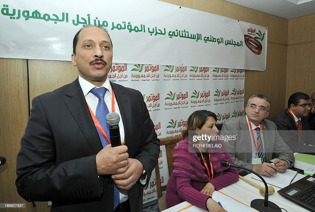 The Secretary General of the Congress Party for the Republic (CPR) Mohamed Abbou addresses the extraordinary National Council of his party as they debate the ministerial reshuffle on February 2, 2013 in Tunis, as members of the provisional government listen on.