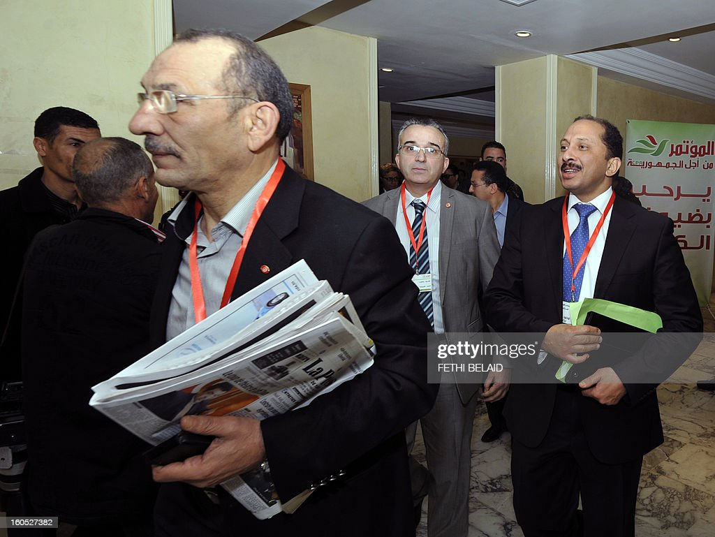 The Secretary General of the Congress Party for the Republic (CPR) Mohamed Abbou (R back) arrives with Abdelwahab Maatar (L back), Minister of Employment and Vocational Training and politburo member, to attend in the extraordinary National Council of their party, on February 2, 2013, in Tunis. AFP PHOTO / FETHI BELAID