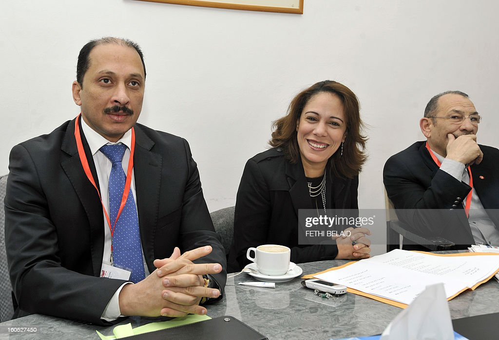 The Secretary General of the Congress Party for the Republic (CPR) Mohamed Abbou (L) sits along side Sihem Badi (C), Tunisian family minister and Abdelwahab Maatar (R), minister of employment and vocational Training, as they attend an extraordinary National Council meeting of their party to debate the ministerial reshuffle, on February 2, 2013, in Tunis.