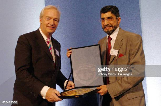 The Secretary General of the Muslim Council of Britain Iqbal Sacranie presents the Ibn Battuta Award for Excellence in Media to Channel 4's Jon Snow...