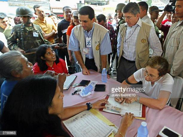 The Secretary General of the Organization of American States Cesar Gaviria inspects a point set up to collect signatures for a referendum to reduce...