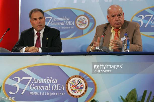 The Secretary General of the Organization of American States Jose Miguel Insulza speaks beside Panamanian Foreign Minister Samuel Lewis during a...
