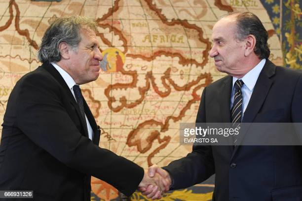 The Secretary General of the Organization of American States Luis Almagro and Brazilian Foreign Minister Aloysio Nunes Ferreira shake hands during a...