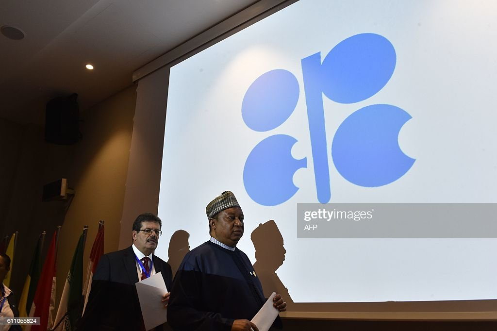 The Secretary General of the Organization of Petroleum Exporting Countries (OPEC) Nigeria's Mohammed Barkindo (R) arrives for a press conference following an informal meeting between OPEC members on September 28, 2016 in the Algerian capital Algiers. / AFP / Ryad Kramdi