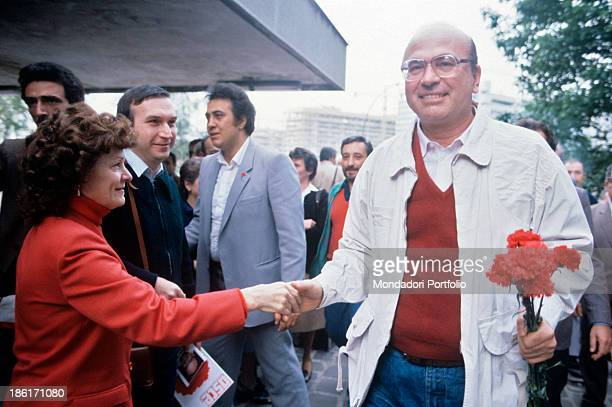 The secretary of Italian Socialist Party Bettino Craxi visiting the Gratosoglio neighbourhood and shaking the hand of a backer Milan 1983