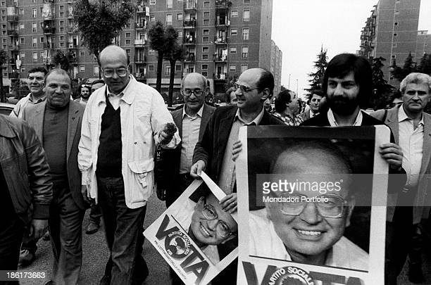 The secretary of Italian Socialist Party Bettino Craxi visiting the Gratosoglio neighbourhood and walking with some backers Milan 1983