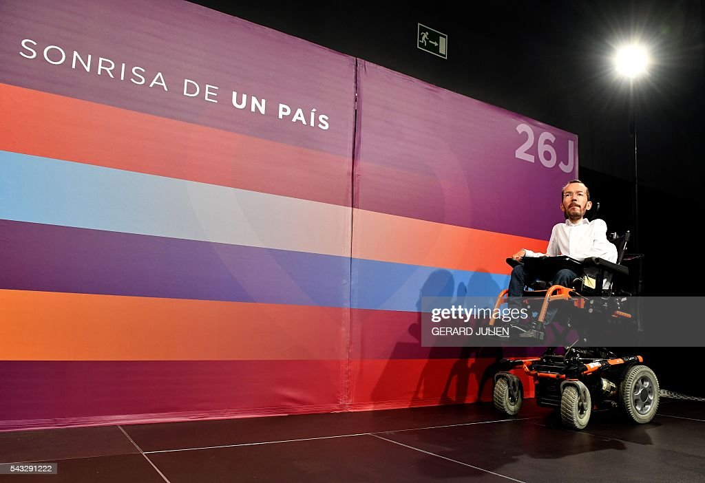 The secretary of organization of left-wing party Podemos, Pablo Echenique arrives for a press conference held one day after the Spanish general elections, in Madrid, on June 27, 2016. Spain hoped on June 27 that repeat weekend elections would unblock the country's political paralysis after the conservatives came out strengthened with more seats, although they still face resistance from hostile rivals. 'The smile of a country.' / AFP / GERARD
