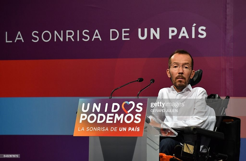 The secretary of organization of left-wing party Podemos, Pablo Echenique gives a press conference held one day after the Spanish general elections, in Madrid, on June 27, 2016. Spain hoped on June 27 that repeat weekend elections would unblock the country's political paralysis after the conservatives came out strengthened with more seats, although they still face resistance from hostile rivals. 'The smile of a country.' / AFP / GERARD