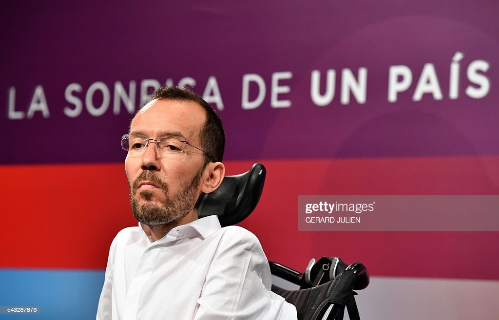 The secretary of organization of left-wing party Podemos, Pablo Echenique gives a press conference held one day after the Spanish general elections, in Madrid, on Juny 27, 2016. Spain hoped on June 27 that repeat weekend elections would unblock the country's political paralysis after the conservatives came out strengthened with more seats, although they still face resistance from hostile rivals. / AFP / GERARD