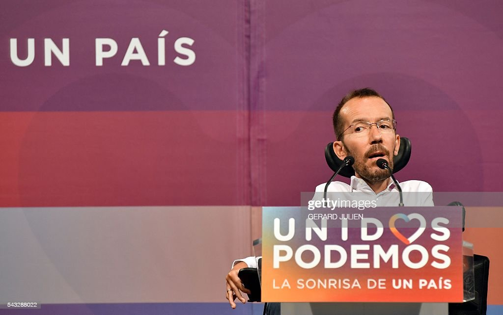 The secretary of organization of left-wing party Podemos, Pablo Echenique gives a press conference held one day after the Spanish general elections, in Madrid, on June 27, 2016. Spain hoped on June 27 that repeat weekend elections would unblock the country's political paralysis after the conservatives came out strengthened with more seats, although they still face resistance from hostile rivals. / AFP / GERARD