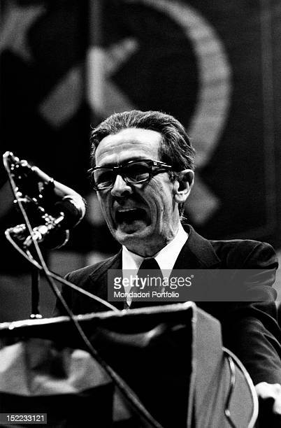 The Secretary of the Italian Communist Party Enrico Berlinguer speaking into the microphone during a political meeting 1980s