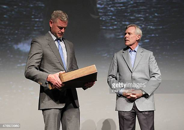 The Secretary of the Navy Ray Mabus presents actor Eric Dane with a Shadow Box containing Navy medals earned by his father at the TNT 'The Last Ship'...
