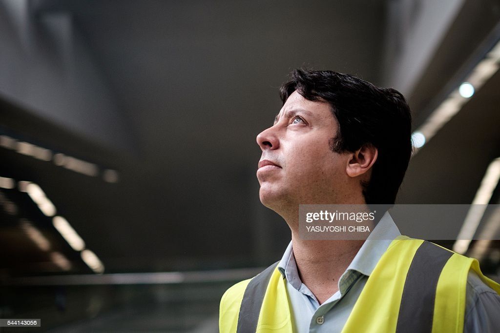 The secretary of transport of Rio de Janeiro State, Rodrigo Vieira, speaks during an interview with the AFP at the under constructing Jardim Oceanico metro station (Line 4), closest to the Olympic Park in Barra da Tijuca, west zone of Rio de Janeiro, Brazil, on July 1, 2016. / AFP / YASUYOSHI