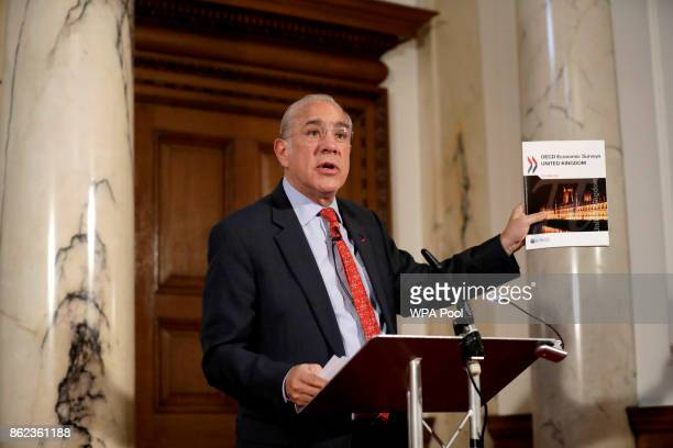 The SecretaryGeneral of the Organisation for Economic Cooperation and Development Angel Gurria from Mexico speaks during an OECD press conference at...