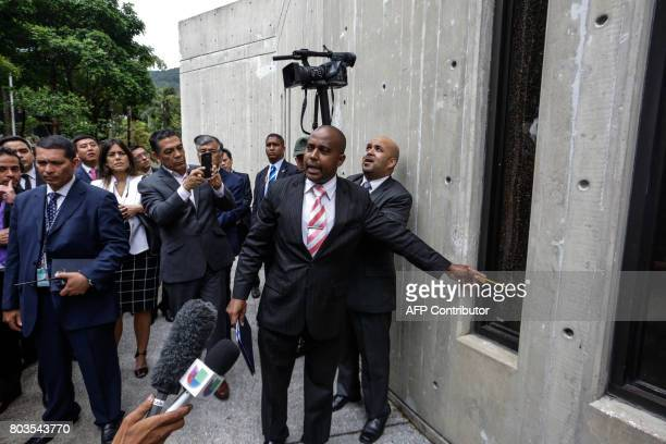 The security director of Supreme Court Jean Carlos Stanford points at a broken window near the place where according to authorities grenades were...