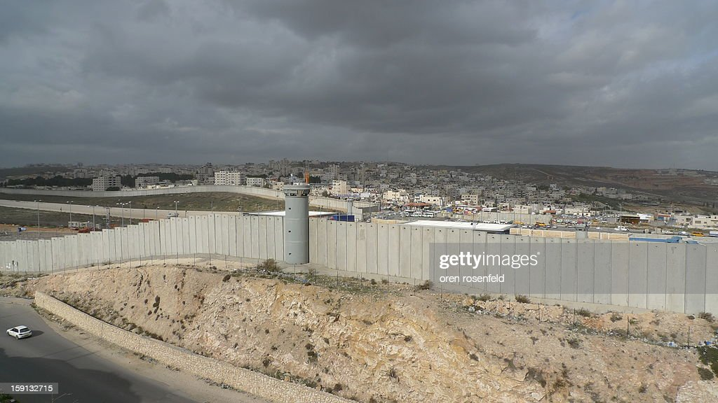 CONTENT] The security wall that separates Israel and Palestine seen here is Ramallah in the distance behind the wall, built by former Israeli Pm Ariel Sharon to try and prevent Palestinian suicide bombers from entering Israel and killing Israelis during the second Palestinian Intifada.