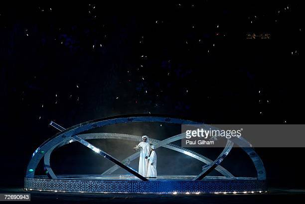 The 'Seeker' and his son perform during the Opening Ceremony of the 15th Asian Games Doha 2006 at the Khalifa stadium on December 1 2006 in Doha Qatar