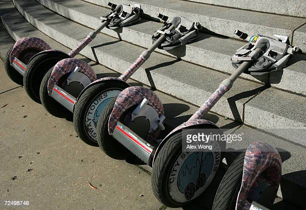 The Segway Human Transporters are placed on a curb prior to a Segway tour November 6 2004 in Washington DC Tourists can now rent the two wheeled...