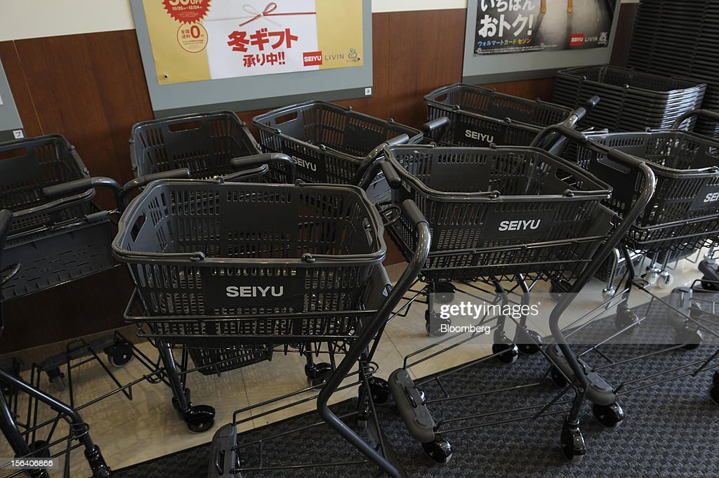 The Seiyu GK logo is displayed on shopping carts in the company's supermarket in Tokyo, Japan, on Wednesday, Nov. 14, 2012. Seiyu GK is a unit of Wal-Mart Stores Inc. Photographer: Akio Kon/Bloomberg via Getty Images