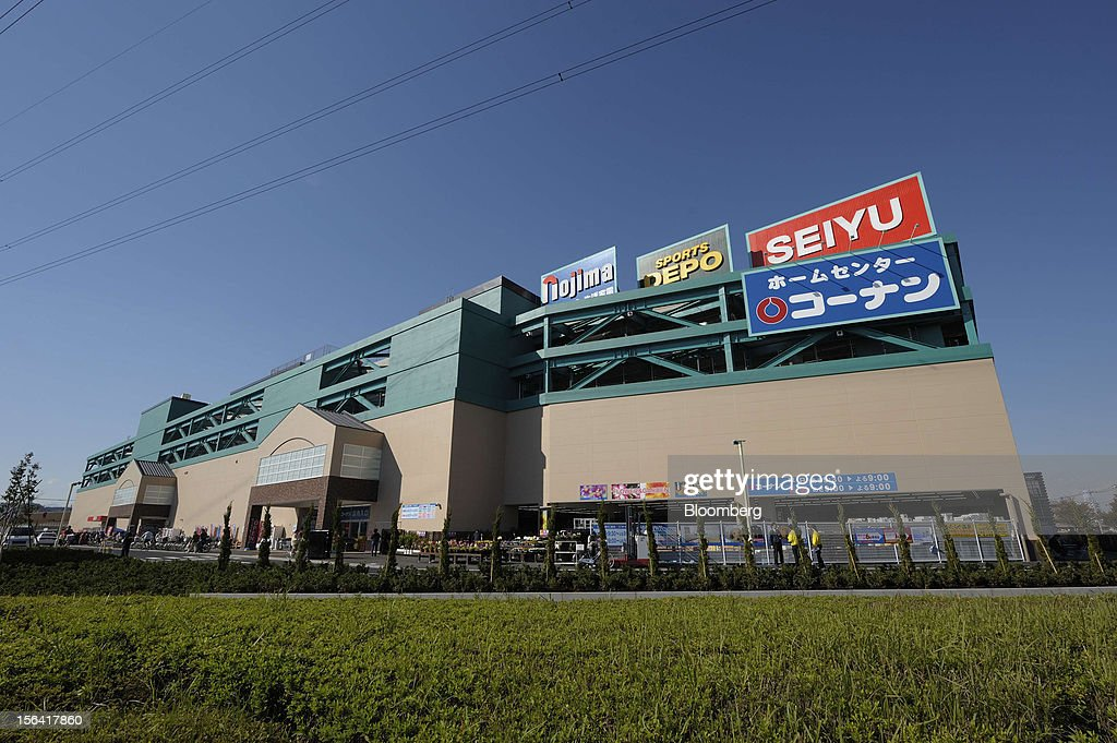 The Seiyu GK logo sits atop a shopping center in Tokyo, Japan, on Wednesday, Nov. 14, 2012. Seiyu GK is a unit of Wal-Mart Stores Inc. Photographer: Akio Kon/Bloomberg via Getty Images