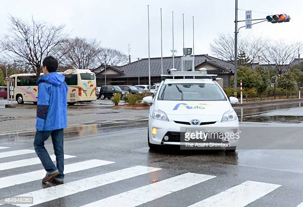The selfdriving car stops in front of a pedestrian during an inaugural trial run on March 1 2015 in Suzu Ishikawa Japan The first driverless car...
