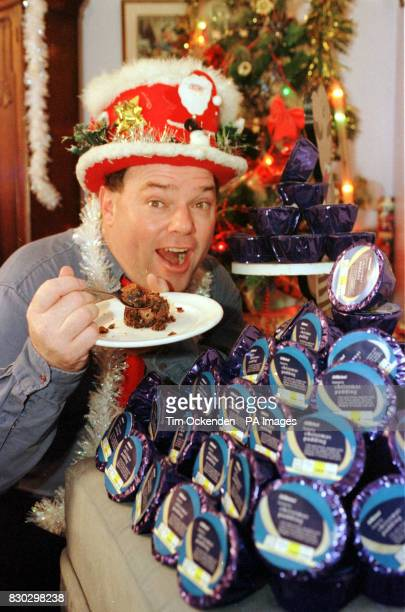 The selfstyled Mr Christmas aka engineer Andy Park with some of the 366 Christmas Puddings given to him free of charge by chain store Marks Spencers...