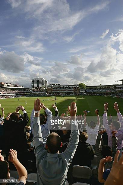 The sell out crowd cheer during the Middlesex v Surrey Twenty20 Cup match at Lords on July 15 2004 in London England