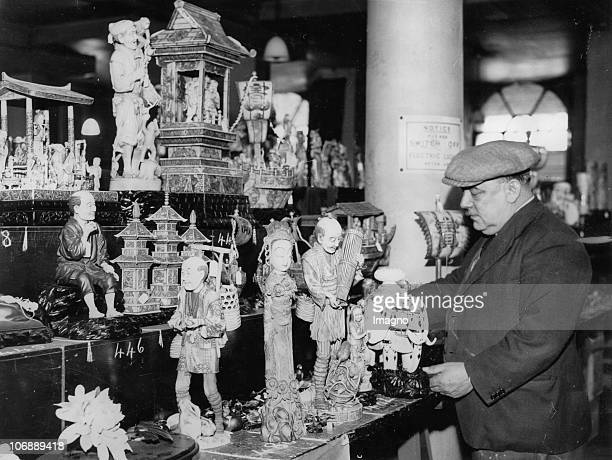 The selling of Japanese ivory carvings Sales of goods from the Far East are periodically held in the London Authority Warehouse in Cutler Street The...