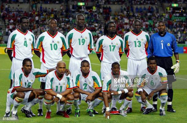 The Senegalese team poses on the green of Osaka Nagai Stadium Japan before match 60 of the 2002 FIFA World Cup Korea Japan quarterfinals 22 June 2002...