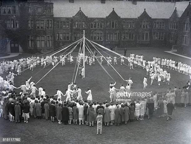 The seniors of Bryn Mawr College holding their 30th annual May Pole Dance on the college grounds