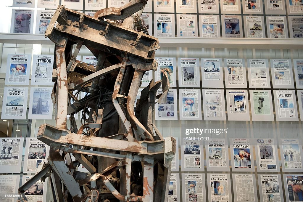 The September 11, 2001 gallery, including a piece of the radio tower from the top of the North Tower of the World Trade Center and front-pages of newspapers from around the world following the terrorist attacks, at the Newseum, a 250,000 square-foot museum dedicated to news, in Washington, DC, on August 2, 2013. AFP PHOTO / Saul LOEB