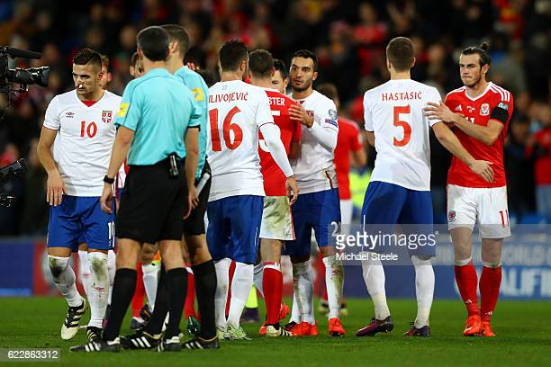 The Serbia and Wales players shake hands at the end of the FIFA 2018 World Cup Qualifier between Wales and Serbia at Cardiff City Stadium on November...