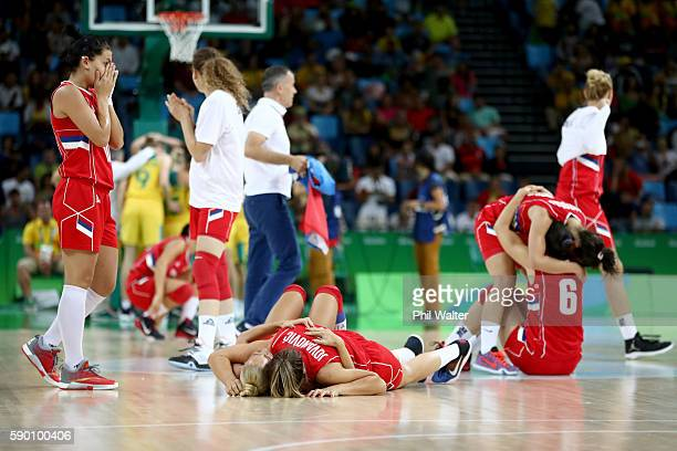 The Serbian team celebrate following the Women's Quarterfinal match between Australia and Serbia at the Carioca Arena 1 on August 16 2016 in Rio de...