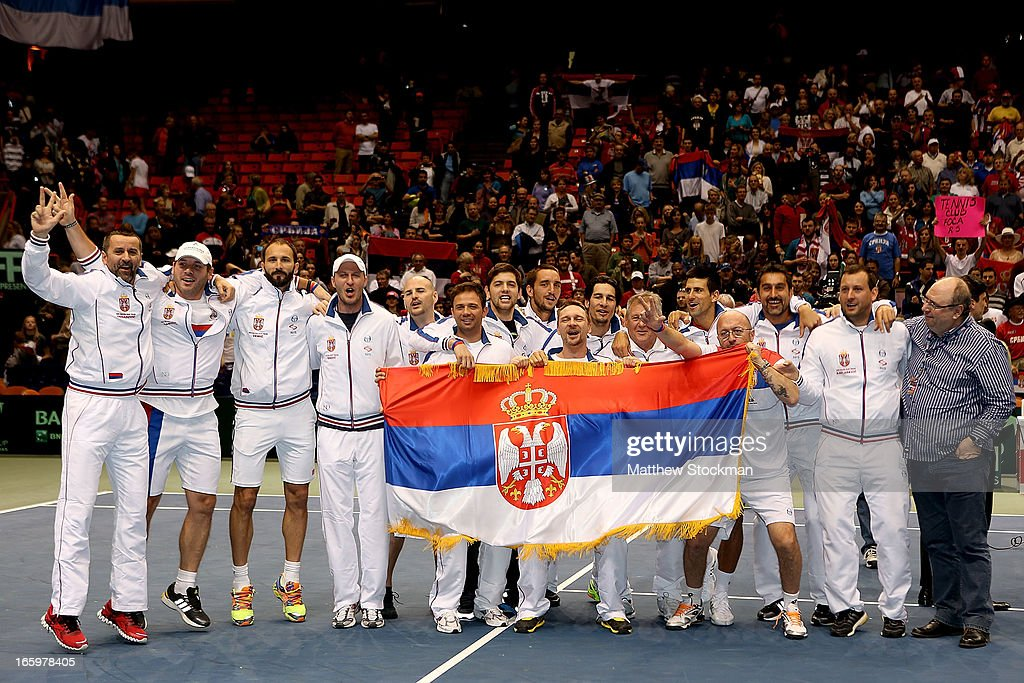 The Serbian team poses for photographers after defeating the US 3-1 during the Davis Cup tie between the United States and Serbia at Taco Bell Arena on April 7, 2013 in Boise, Idaho.
