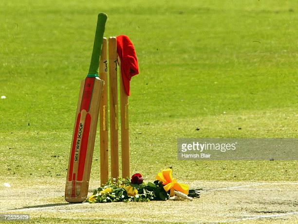 The set of stumps used in David Hookes' last game for South Australia as well as a bat and South Australian red cap arrange in tribute in the centre...