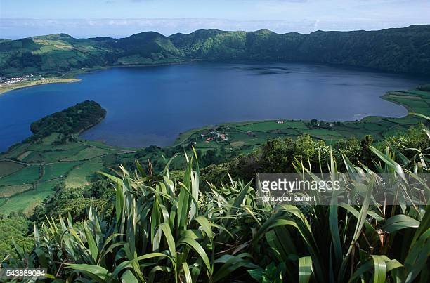 The Sete Cidades or Seven Cities is a set of twin lakes located in the center of a volcanic crater in the west of Sao Miguel Island in the Azores