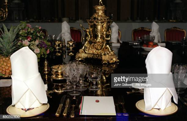 The setting on the banquet table in St Georges' Hall at Windsor Castle including glasses and cutlery bearing the royal insignia for the State Banquet...