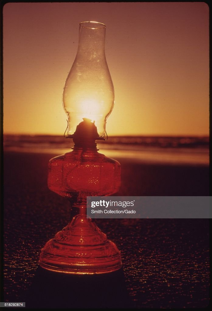 The Setting Sun and Glass Lantern Symbols of Solar Energy and Manmade Lighting Along the Oregon Coast near Lincoln City During the Energy Crisis of...