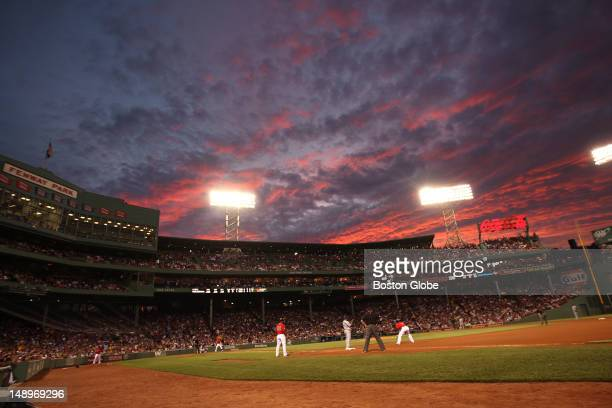 The setting sun creates a canvas of colors over Fenway Park during the fourth inning as the Boston Red Sox took on the Toronto Blue Jays at Fenway...