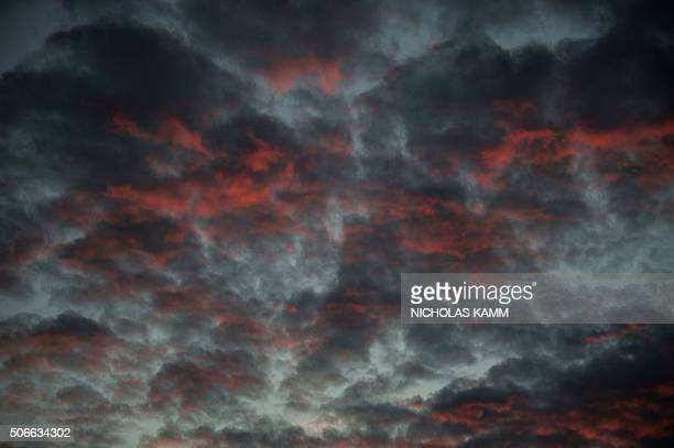 The setting sun is reflected in clouds in Washington DC following a massive snowstorm on January 24 2016 Millions of people in the eastern United...