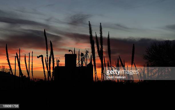The setting sun is seen over downtown on December 25 2012 in Marfa Texas Situated in West Texas this town of just over 2000 residents has become a...