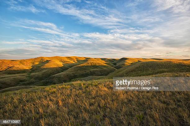 The Setting Sun Lights Up The Top Of The Coulees In Grasslands National Park