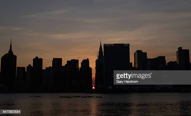 The setting sun moves across 42nd Street on the second night of Manhattanhenge in New York City on July 12 2016