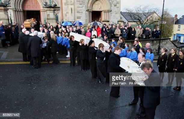 The seven coffins of the McEhill family are removed for burial after requiem mass at Sacred heart church in Omagh