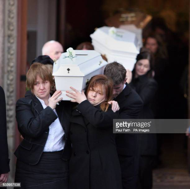 The seven coffins of the McEhill family are removed for burial after requiem mass at the Sacred Heart church in Omagh