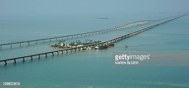 The Seven Mile Bridge and Pigeon Key are seen from the air looking south from Marathon Florida February 22 2011 The Seven Mile Bridge connects...